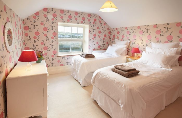 First floor: Double bedroom with zip and link which can convert to a double upon request with wonderful views over rural countryside