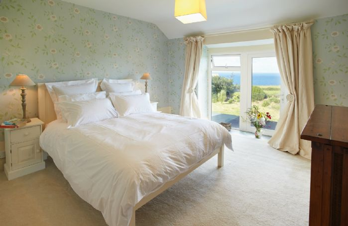 First floor: Double bedroom with sea views and en-suite bathroom with bath and separate shower
