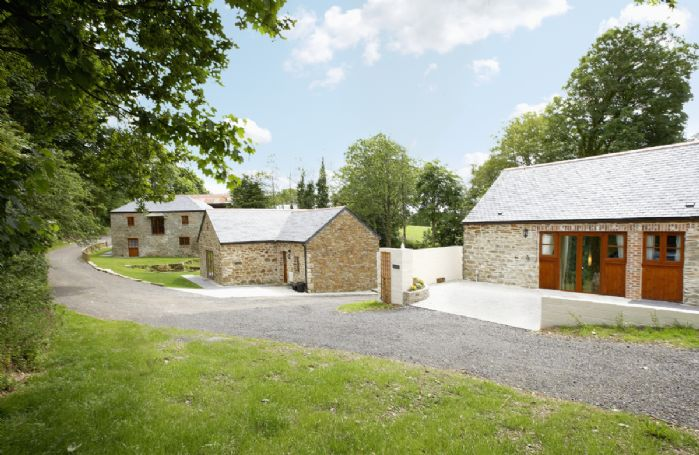 At the end of a private gated road, our three spacious and luxuriously appointed detached cottages offer peaceful seclusion in a beautiful setting within natural woodland and all grass farmland