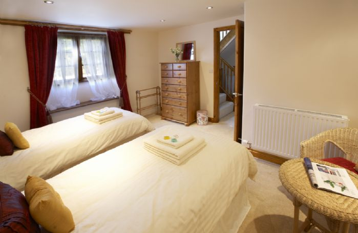Ground floor: Twin bedroom with 3' zip and link beds which can be converted to 6' bed upon request