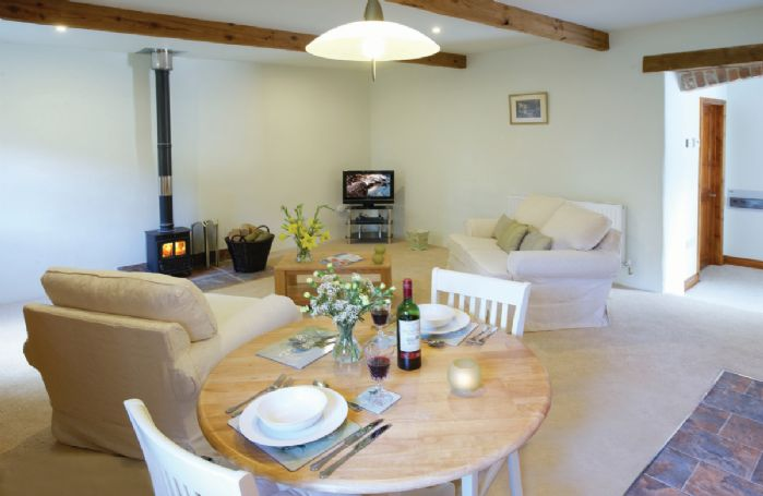Ground floor: Open plan kitchen, dining and sitting area with wood burning stove