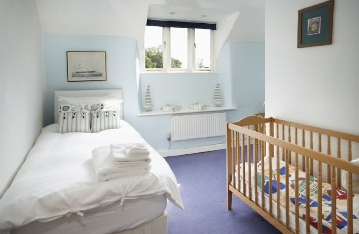 First floor: Single bedroom with a 3' bed and cot available if needed