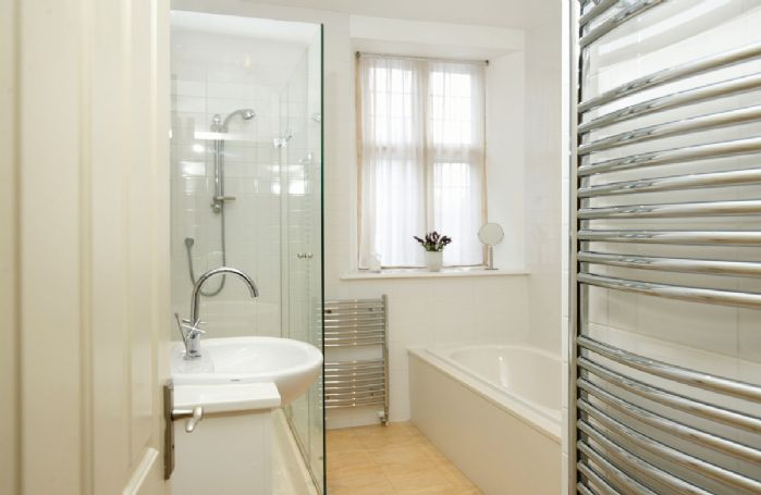 First floor: Family bathroom with bath and large shower recess