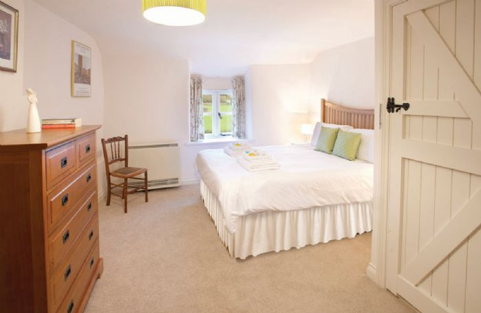 First floor: Double bedroom with 5ft bed and en-suite bathroom with separate shower