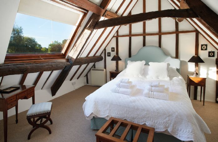 Second floor: Light and airy master bedroom with 5' bed and stunning views on to the cottage's garden