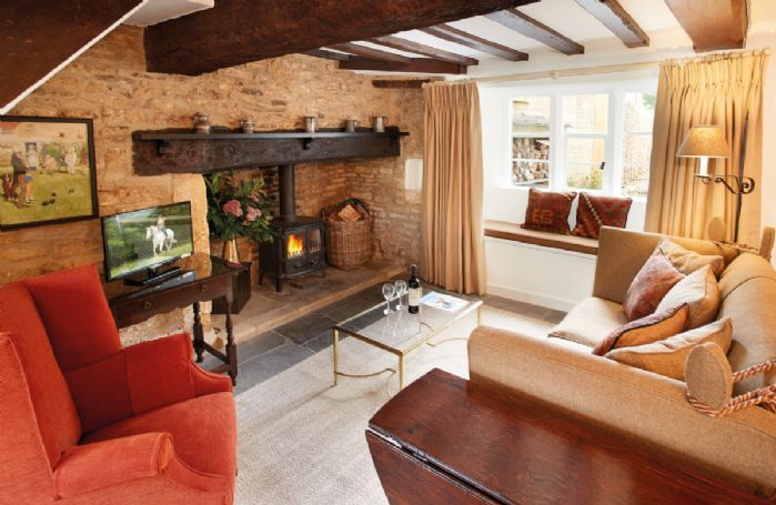 Ground floor: Sitting room with flagstone floors and inglenook fireplace with woodburning stove