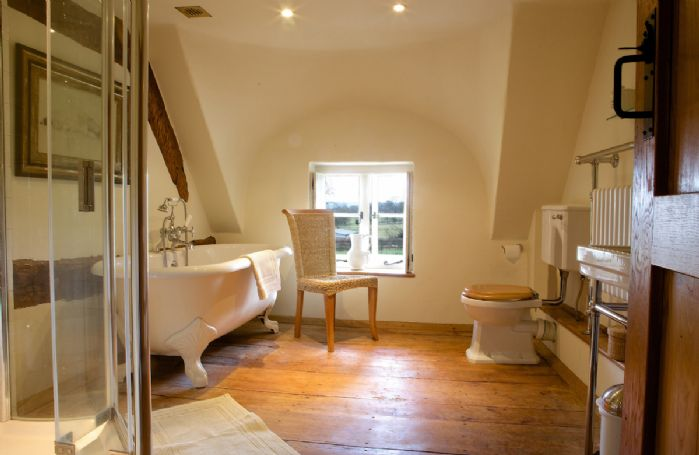 Field Cottage: First floor, Bathroom with a roll top bath, separate shower and heated towel rail