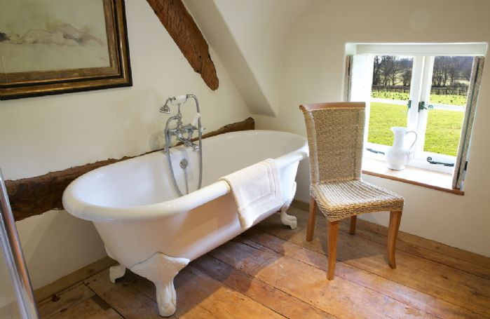 Field Cottage: First floor, roll top bath with a view