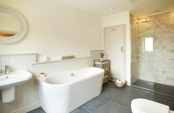 Ground floor: En-suite bathroom with separate shower