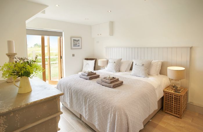 Ground floor: Double bedroom with 6' zip and link bed and en-suite shower room