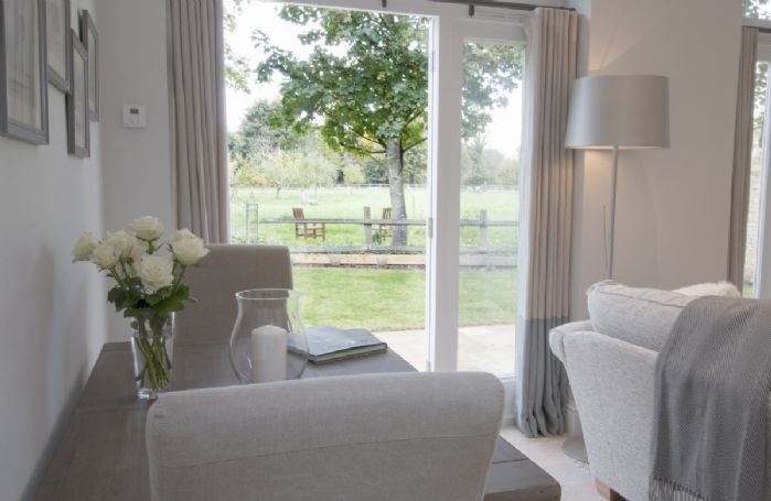 Ground floor:  Sitting room opening out onto garden