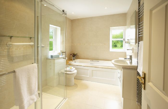 First floor: En-suite bathroom with walk in shower
