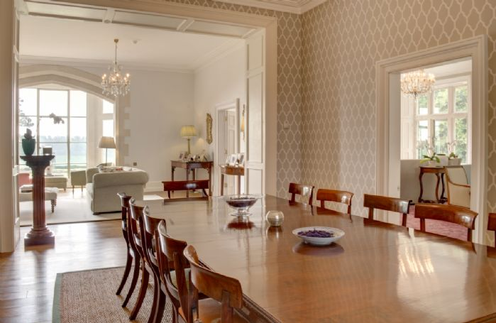 Ground floor: Dining room with table and chairs seating 12 guests
