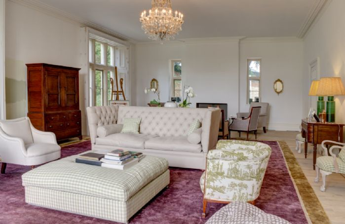 Ground floor: The drawing room features floor to ceiling windows with wooden shutters