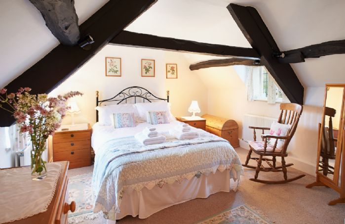 First Floor: Large master double bedroom with 5' bed, original beams and dormer windows