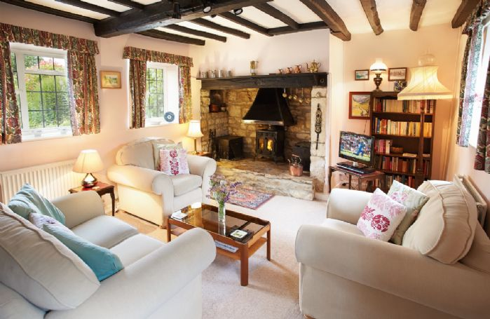 Ground floor:  Sitting room with original inglenook fireplace and wood burning stove