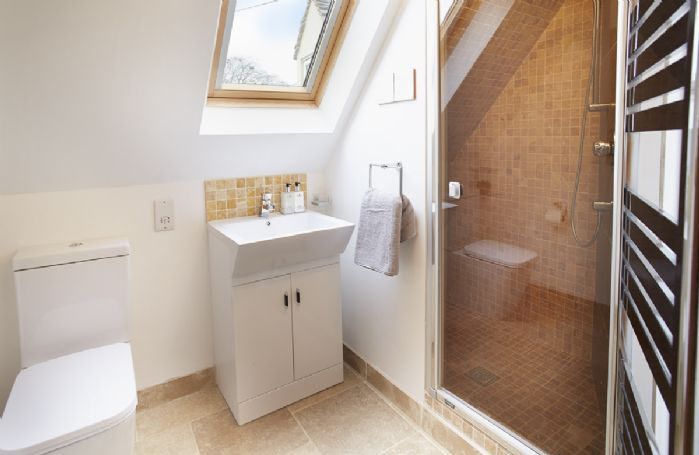 First floor:  En-suite bathroom with spacious shower