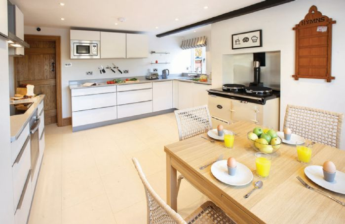 Ground floor: Contemporary kitchen with Aga and separate electric hob and oven