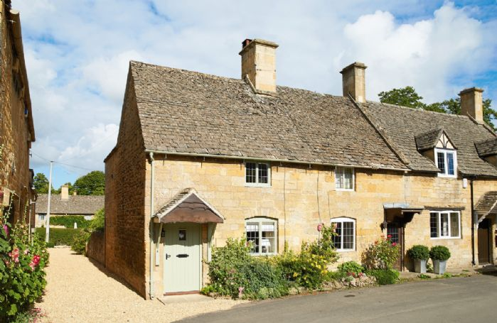 Midsummer Cottage is a delightful 17the century Grade II listed Cotswold stone cottage with a very pretty garden