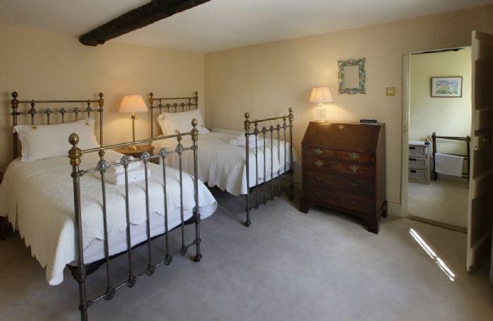 First floor: Twin bedroom with 3' beds and en-suite bathroom
