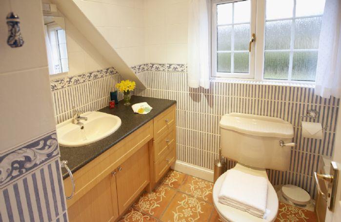 En-suite bathroom to the first floor double bedroom