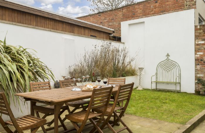 To the rear of Moorend Townhouse is a fully enclosed walled garden with garden furniture