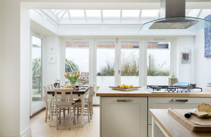 Ground floor: The conservatory/dining area overlooks a fully enclosed walled courtyard garden