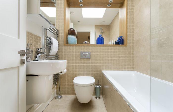 First floor: Family bathroom with bath and overhead shower