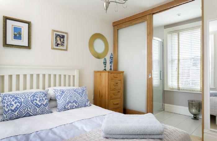 First floor: Bedroom with 4'6 double bed and en-suite shower room