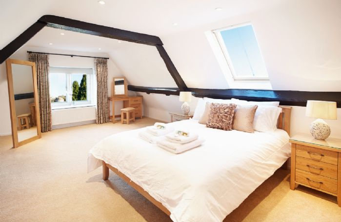 Second floor: Double bedroom with 6' bed and en-suite bathroom with shower over bath