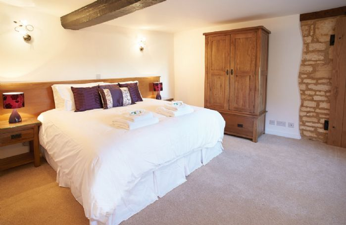 First floor: Double bedroom with 6' zip and link bed with en suite bathroom with shower over bath