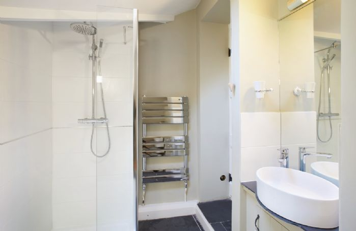 Ground floor: Bathroom with bath/shower over and wc