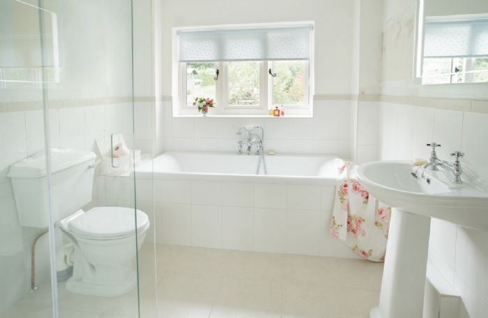 First floor: Bathroom with bath and separate shower