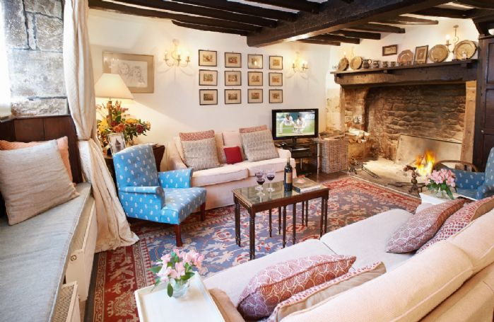 Ground floor:  Beamed sitting room with inglenook fireplace and open fire