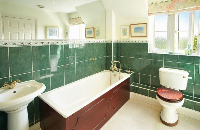 First floor: En-suite bathroom with hand held spray attachment to master bedroom