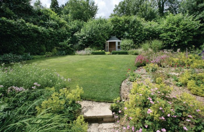 Enjoy a picnic on the lawn or retreat to the summer house for a little more comfort