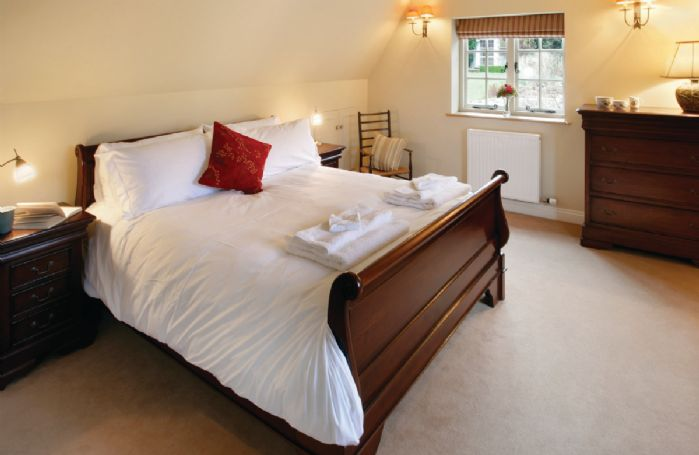 First floor: Double bedroom with 5' bed and en-suite shower room