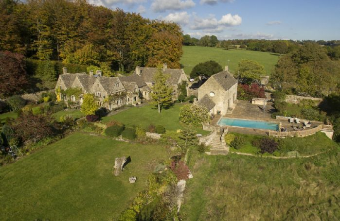 An aerial view of The Manor House with it's lovely gardens and swimming pool