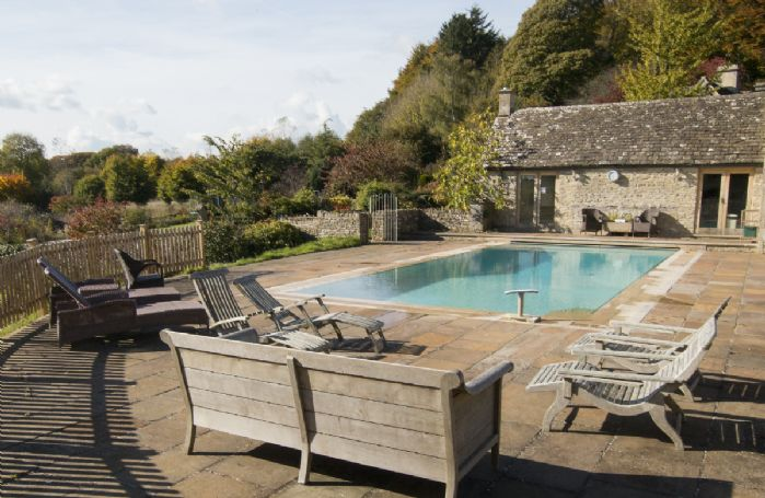 Outdoor heated swimming pool with changing rooms available from May to September