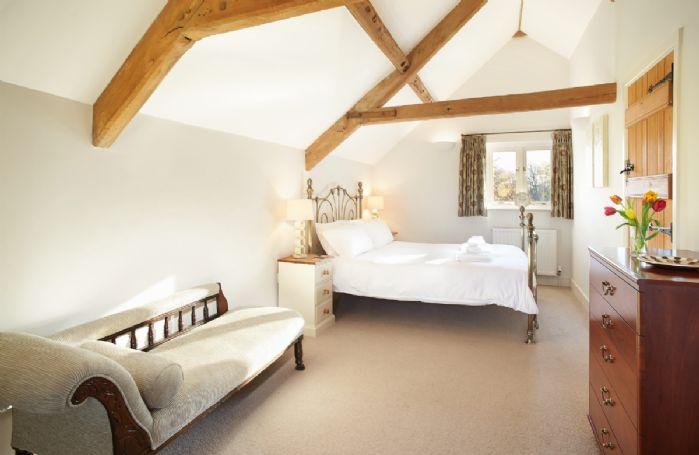 First floor: Master bedroom with 5' bed and en-suite bathroom