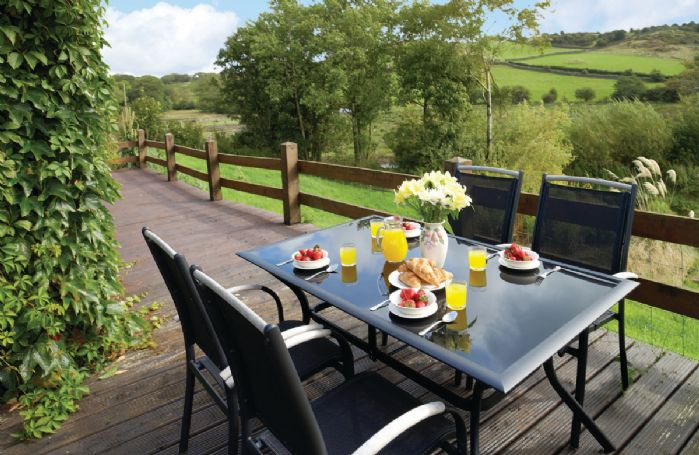 The decked patio and surrounding countryside.The Cumbria Way passes the front of the property, ideal for walkers