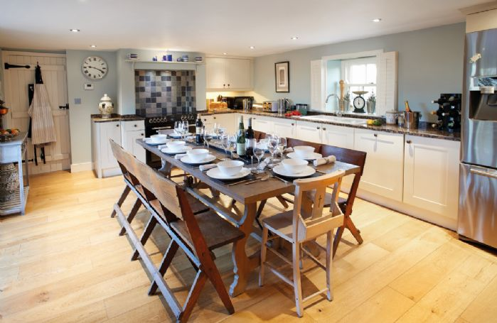 Ground floor: Large well-equipped kitchen with dining table seating 10 guests and wonderful views onto the courtyard and garden
