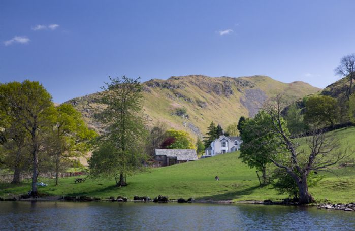 The Great Barn enjoys uninterrupted panoramic lake views across Ullswater to the Lakeland Fells beyond