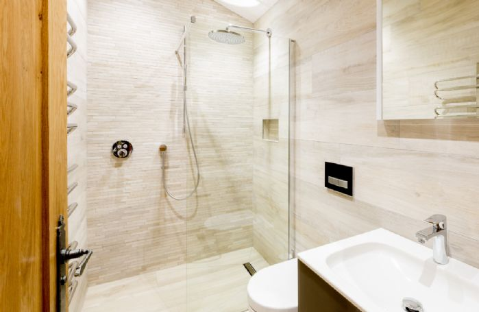Ground floor: Butterwick - En-suite natural stone shower room with walk in monsoon and raindrop shower