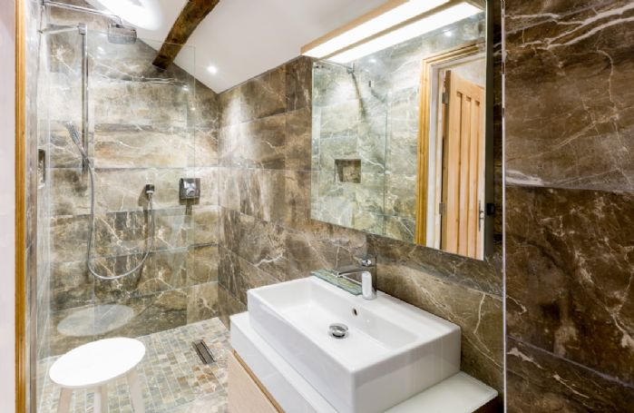 First floor: Cockpit - en-suite natural stone bathroom with bath and separate monsoon and raindrop shower