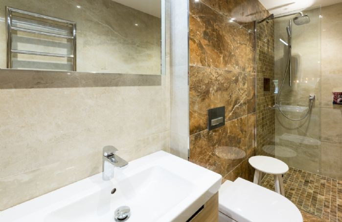 Ground floor: Loadpot - En-suite natural stone shower room with walk in monsoon and raindrop shower