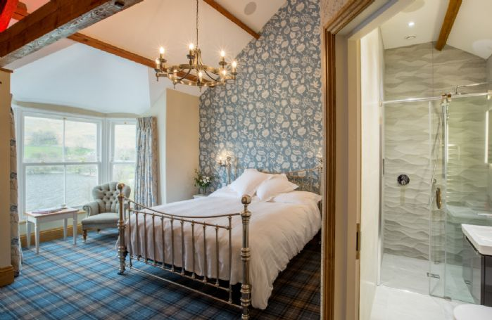 First floor: Fusedale has a 6' super king bed with Vispring Elite mattress and en-suite natural stone shower room with monsoon and raindrop showers