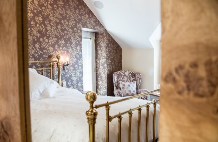 First floor: Boredale has a 5' king size bed with Vispring Elite mattress and en-suite natural black stone shower room with monsoon and raindrop showers, a Lake View balcony and private access to Waternook's Spa and Wellness Sanctuary