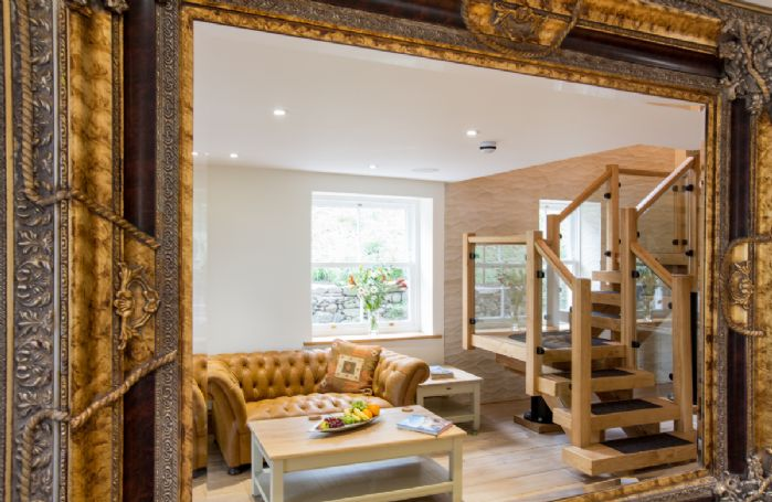 Waternook: Drawing room with wood burning stove and reading room