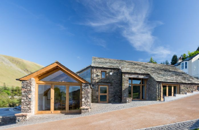 The Great Barn sits on the edge of Ullswater Lake and is surrounded by stunning Lakeland fells